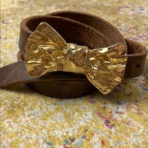 Anthropologie belt with gold bow buckle
